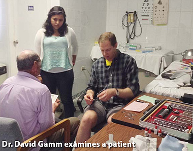 Dr. David Gamm examines a patient